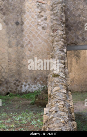 Herculaneum, Italy. Close up of wall showing detail, in the ruins of  the ancient coastal Roman town of Herculaneum / Ercolano near Naples, Italy. - Stock Photo