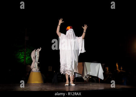 Merida, Cementerio General, Mexico - 31 October 2018: Woman with ghost costume and skull make-up introducing the procession and parade for dia de los  - Stock Photo