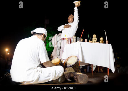 Merida, Cementerio General, Mexico - 31 October 2018: Maya ceromony for the holiday Hanal Pixan on the stage with musician and ceremony leader praying - Stock Photo