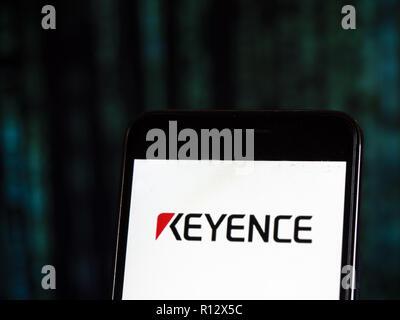 Keyence Company logo seen displayed on smart phone  Keyence