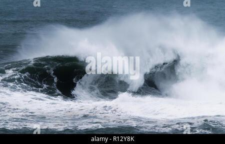 Storm waves crash Towan Beach promenade Newquay Cornwall UK.  Newquay, Cornwall, UK. - Stock Photo