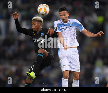 Rome, Italy. 8th Nov, 2018. Lazio's Luis Felipe (R) vies with Marseille's Clinton Njie during the UEFA Europa League Group H match between Lazio and Marseille in Rome, Italy, Nov. 8, 2018. Lazio won 2-1. Credit: Alberto Lingria/Xinhua/Alamy Live News - Stock Photo