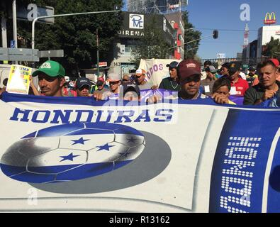 Mexico City, Mexico. 8th Nov 2018. Members of the migrant caravan walk in Mexico City, Mexico, 8 November 2018. Members of the caravan of Central American migrants demanded before the Office in Mexico of the UN High Commissioner for Human Rights that they be provided with buses to arrive safely at the border with the United States. EFE/ Alex Cruz Credit: EFE News Agency/Alamy Live News - Stock Photo