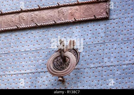 Bronze knocker details with a dragon from the back door  of the La Lonja, The Llotja de la Seda or the La Lonja Silk Exchange  Valencia, Spain - Stock Photo