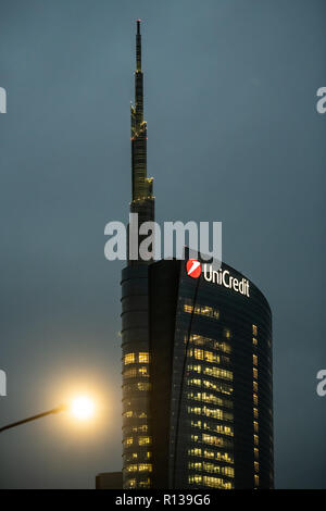 Unicredit Tower headquarter office building at night with  illuminated windows in Porta Nuova, Milan, Italy on November 8, 2018. - Stock Photo