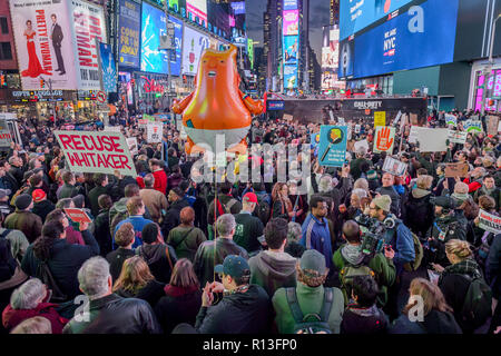New York, United States. 08th Nov, 2018. Thousands of New Yorkers joined a coalition of grassroots organizations in New York City in a massive demonstration on November 8, 2018 in Times Square to denounce new acting Attorney General Matthew Whitaker may have a conflict of interest and must not oversee the investigation led by Special Counsel Robert Mueller into Russian interference in the 2016 election and related crimes by Trump campaign officials and associates. Credit: Erik McGregor/Pacific Press/Alamy Live News - Stock Photo