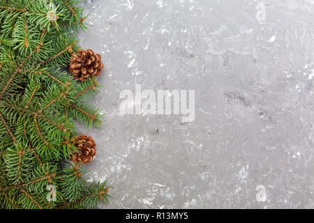 Christmas gray cement wooden background with fir tree frame and cones copy space. top view empty space for your design. - Stock Photo