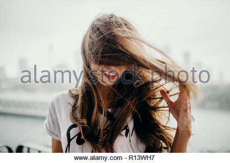 A brunette woman with windswept hair - Stock Photo