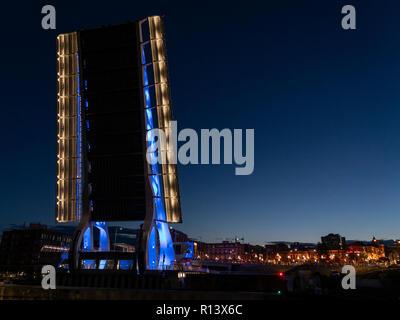 The new Johnson Street Bridge in Victoria, British Columbia, Canada, seen raised at dawn. - Stock Photo