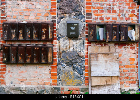 Old mailboxes of the Soviet era in a building of Krimulda, near Sigulda, Gauja National Park, Krimulda, Latvia, Baltic states, Europe. - Stock Photo