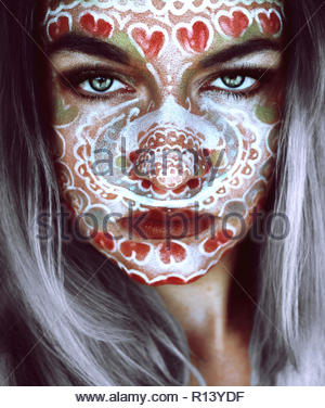Portrait of a woman wearing face paint looking into the camera - Stock Photo