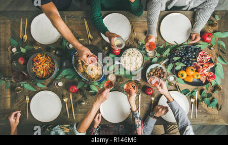 Flat-lay of friends or family feasting at festive table - Stock Photo