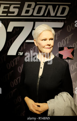 Wax figure of Dame Judith Olivia Dench at world renowned tourist attraction Madame Tussauds Wax museum in London, United Kingdom. - Stock Photo