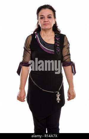 Studio shot of mature Persian woman standing - Stock Photo