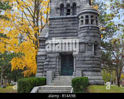 Mount Pleasant Cemetery is an old cemetery in a park-like setting with mature trees and some large family mausoleums. Massey Family Mausoleum. - Stock Photo