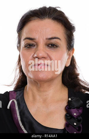 Face of mature Persian woman with hair tied - Stock Photo
