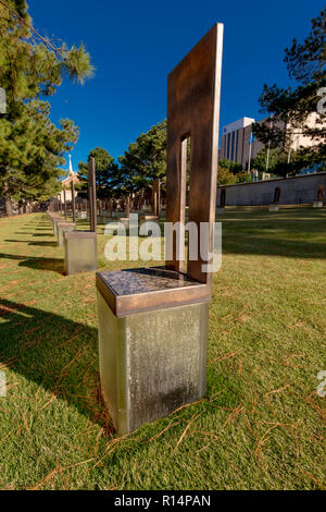 OCTOBER 11,2018  - Oklahoma City, USA - Empty Chair at Oklahoma City National Memorial  & Museum shows empty chairs - Stock Photo