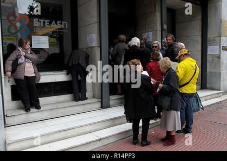 Daily life in Athens. Pensioners are waiting in line to be served at the public service. - Stock Photo
