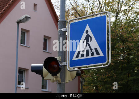 Road signs on the streets. Road Sign Pedestrian Crossing - Stock Photo