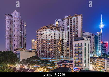 KUALA LUMPUR, MALAYSIA - JULY 24: View of downtown Kuala lumpur city buildings at night on July 24, 2018 in Kuala Lumpur - Stock Photo