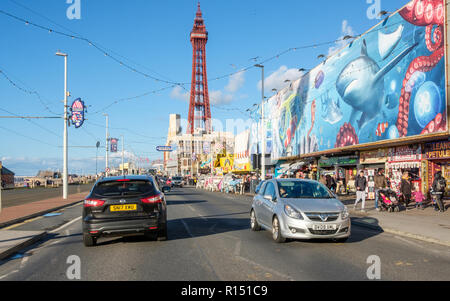 Blackpool promenade during an autumn weekend. Blackpool is one of Englands favorite seaside resorts. - Stock Photo