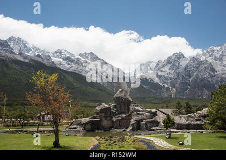Snow covered Jade Dragon Mountains in the Yunnan province of China. - Stock Photo