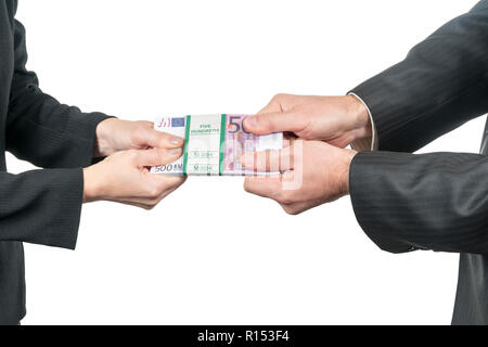 man and a woman are pulling each other a pack of euro money isolated on a white background - Stock Photo