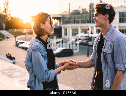 Lovely young hipster couple dating during summer sunset. - Stock Photo