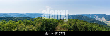 Germany, XXL panorama of scenic viewpoint over black forest landscape and village in valley - Stock Photo