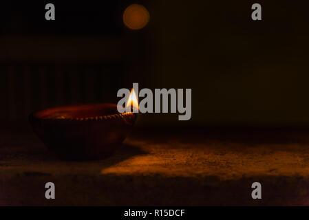 Diwali light using traditional diwa made of earth soil - Stock Photo