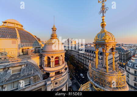 PARIS, 25 October 2018 - Sunset on the Paris' roofs and the Paris Opera Garnier building in the Haussmann district, France - Stock Photo