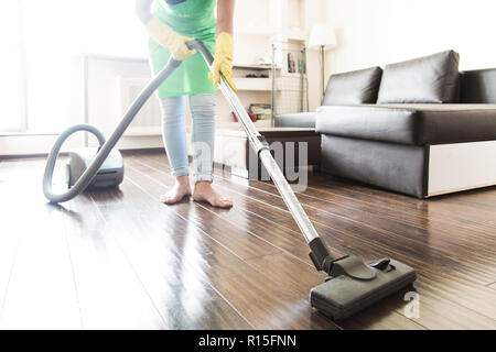 cleaning service. dust removal with vacuum cleaner. clean floor at home - Stock Photo