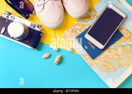 background for a trip - watches, sneakers, map, dollars, glasses, camera, headphones, passport - Stock Photo