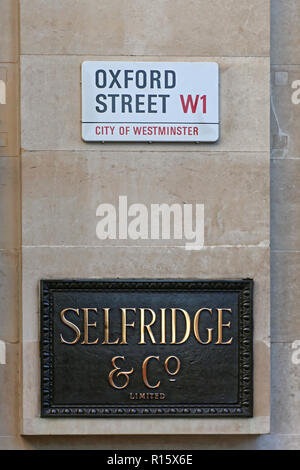 London, United Kingdom - November 21, 2013: Selfridge Luxury Department Store Plaque Sign at Oxford Street in London, UK. - Stock Photo