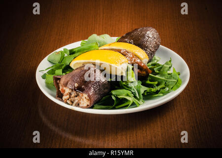 Pickled stuffed eggplant with vegetables and sliced lemon - Stock Photo