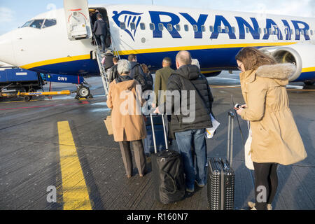 Passengers boarding a Ryanair plane at Dublin Airport - Stock Photo