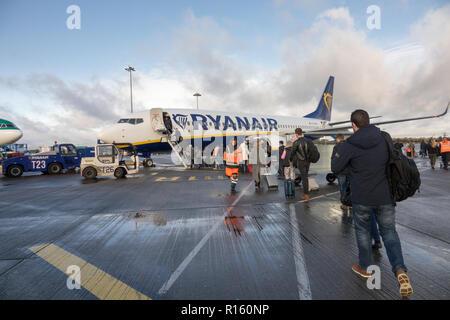 Passengers boarding a Ryanair plane at Dublin Airport - Stock Photo