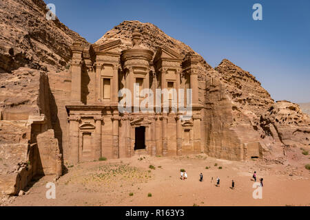 Tourist enjoying the grandeur of Al Deir or The Monastery at Petra in Jordan - Stock Photo