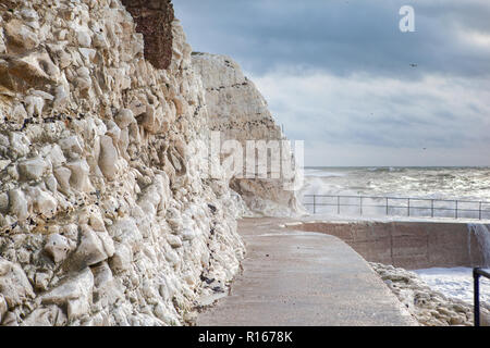 View of eastern part of Seaford beach in a stormy weather, East Sussex. England, cliffs, sea and cloudy sky, selective focus - Stock Photo
