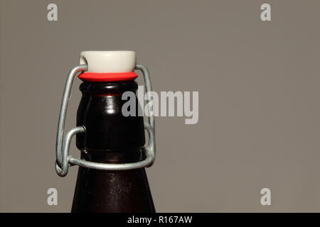 A close up view of a Brown Antique Bottle Top on the Left Side - Stock Photo