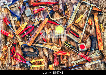 Close up of a group of tools on a wooden background. - Stock Photo