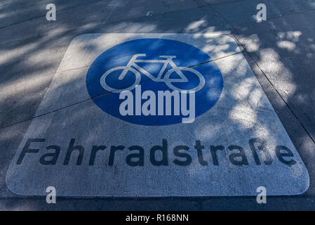 Sign on the asphalt for a bicycle road, Berlin, Germany - Stock Photo