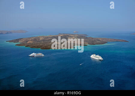 Cruise ships off the volcanic island Nea Kameni, Caldera, Fira, Santorini, Cyclades, Aegean Sea, Greece - Stock Photo