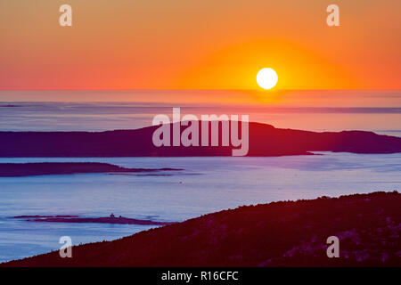 Sunrise in Acadia National Park observed from the top of Cadillac mountain. - Stock Photo