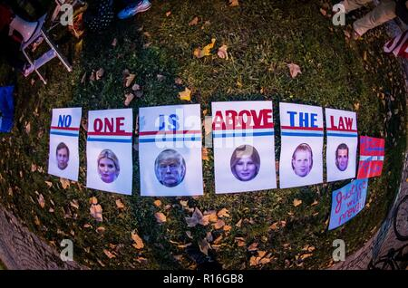 Munich, Bavaria, Germany. 9th Nov, 2018. In response to the forced resignation of Attorney General Jeff Sessions, American expatriates in Munich, Germany protested in front of the American Consulate in one of over 900 worldwide 'Nobody is Above the Law'' protests. The protestors fear that Trump is making moves to prematurely end the Special Counsel Investigation by Robert Mueller into foreign interference in the 2016 presidential election.In the course of the investigation, criminal proceedings have been initiated against 33. The acting AG Matthew G. Whitaker is known to be a Trump s - Stock Photo