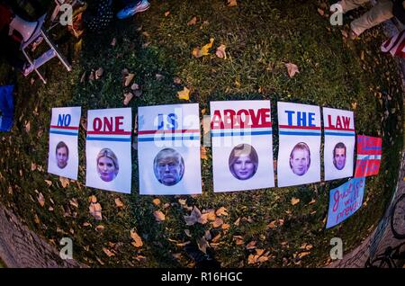 Munich, Bavaria, Germany. 9th Nov, 2018. In response to the forced resignation of Attorney General Jeff Sessions, American expatriates in Munich, Germany protested in front of the American Consulate in one of over 900 worldwide 'Nobody is Above the Law' protests. The protestors fear that Trump is making moves to prematurely end the Special Counsel Investigation by Robert Mueller into foreign interference in the 2016 presidential election. Credit: Sachelle Babbar/ZUMA Wire/Alamy Live News - Stock Photo