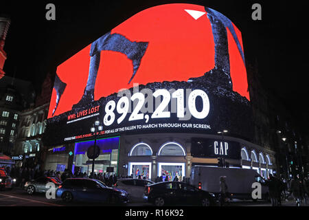 London, UK. 9th Nov, 2018. The screens of Piccadilly Circus swapped advertising for Armistice messages and marching feet ahead of a two minute silence observed at 7pm in remembrance of the 100th anniversary of the Armistice at Piccadilly Circus in London. Crowds gathered to watch as the sound of marching feet echoed through the surrounding streets. Credit: Paul Brown/Alamy Live News - Stock Photo