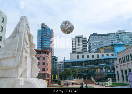 WELLINGTON, NEW ZEALAND - OCTOBER 1 2018; Silver steel globe comprising of and called Ferns shaped floating above Civic Square by artist Neil Dawson i - Stock Photo