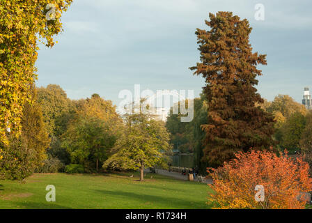 Historic St James's Park in the afternoon sunshine with autumnal colours on a variety of trees. - Stock Photo