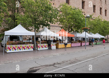 Stalls selling local produce outside the walls of the Montserrat Monastery, Monserrat, Barcelona, Spain - Stock Photo